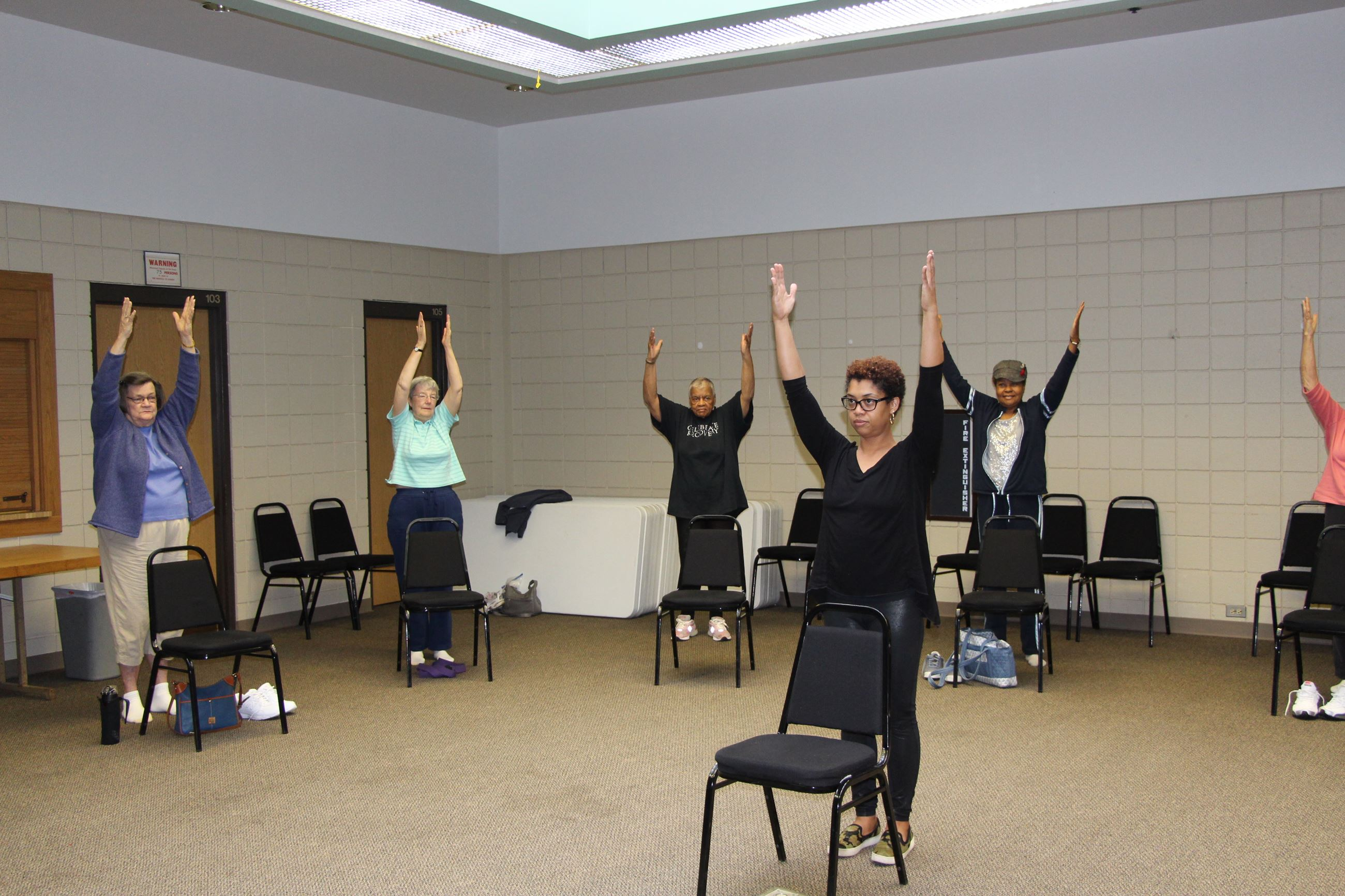 Older Adults doing Chair Yoga